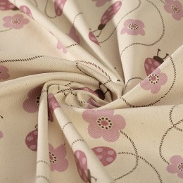 Cream organic cotton twill with ladybugs print